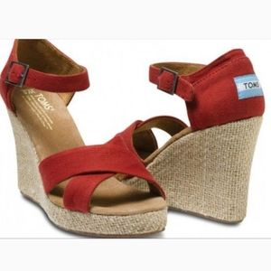 Red Tom's strappy canvas sandals...